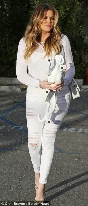 White hot! Khloe Kardashian parades her figure in tight outfit
